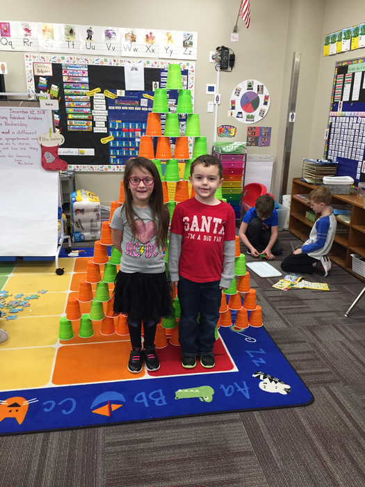 Aleena and Espen build a tall tower