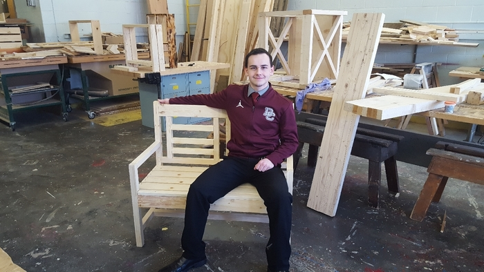 Karson Poole with the bench he constructed.